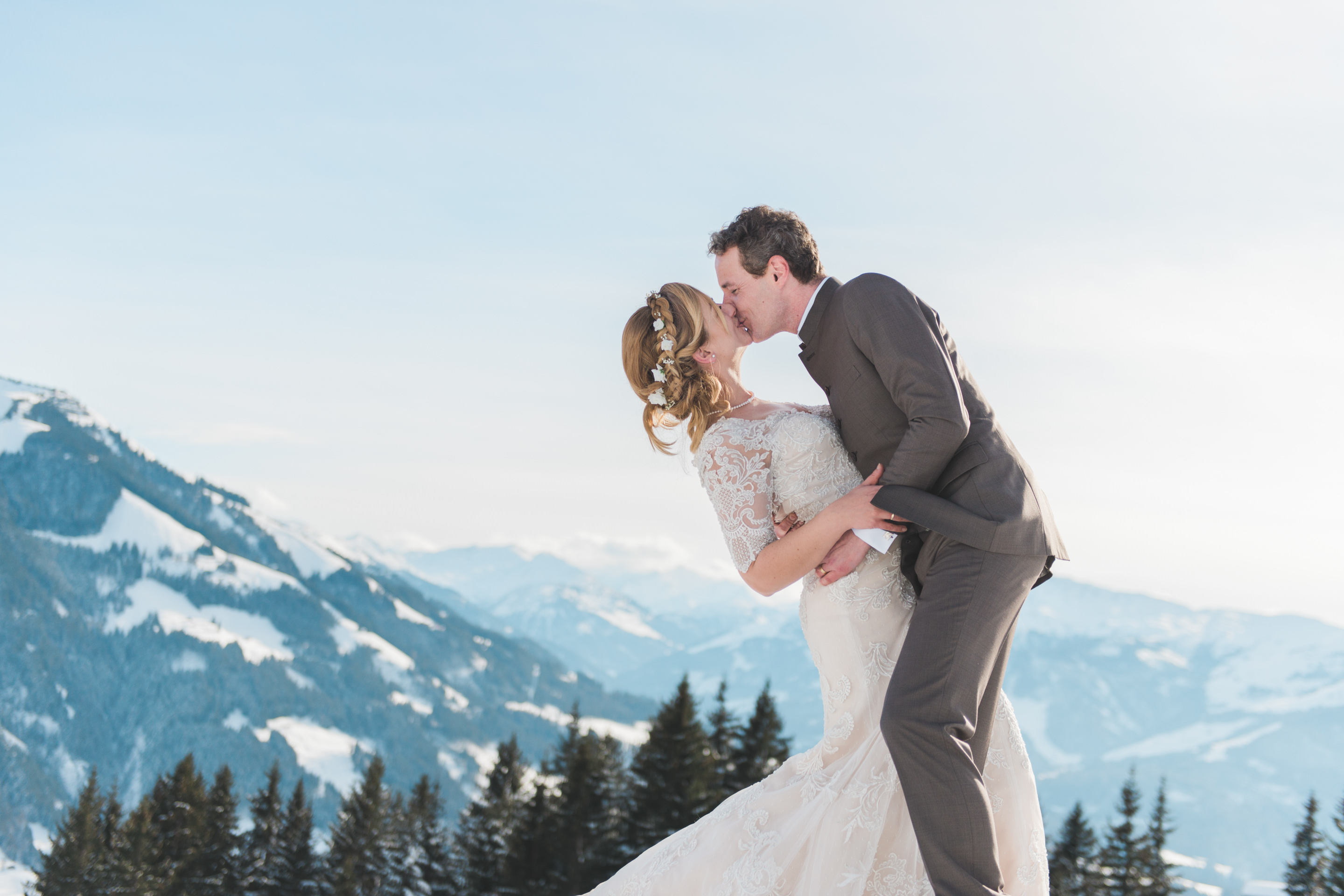Bride and Groom at a fun wedding in Austria on top of a mountain