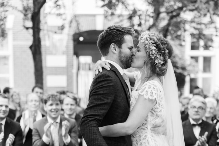 Bride and groom kissing their first kiss in Amsterdam